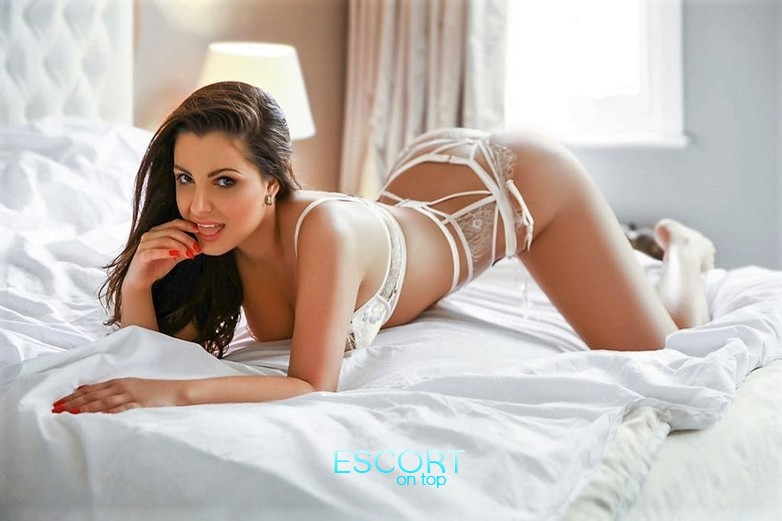 melody busty escort girl in high street kensington london